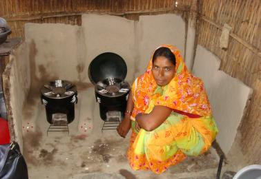 Woman cooks on cookstove in India
